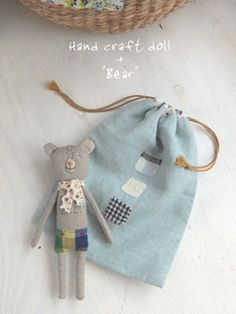 fabric bear with appliqued drawstring bag