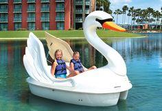 Swan paddle boat on Crescent Lake at the Walt Disney World Swan and Dolphin at Walt Disney World, Florida.