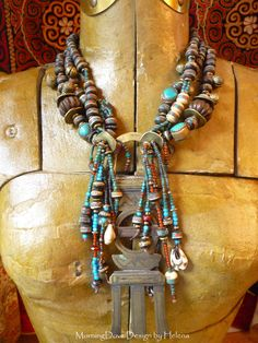 Necklace | Helena Nelson-Reed.  'Desert Queen'.  Tuareg silver, brass and copper veil weight is combined with bone beads inlaid with turquoise and coral chips, glass seed beads, old cowrie shells from Nepal, among other beads.