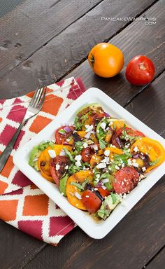 Quick summer avocado salad. Rich buttery avocado paired with juicy ripe summer tomatoes with reduced balsamic drizzled over the top. | http://www.pancakewarriors.com
