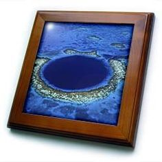 "Aerial of the Blue Hole, Lighthouse Reef, Belize - SA02 GJO0170 - Greg Johnston - 8x8 Framed Tile by 3dRose. $22.99. Solid wood frame. Cherry Finish. Dimensions: 8"" H x 8"" W x 1/2"" D. Keyhole in the back of frame allows for easy hanging.. Inset high gloss 6"" x 6"" ceramic tile.. Aerial of the Blue Hole, Lighthouse Reef, Belize - SA02 GJO0170 - Greg Johnston Framed Tile is 8"" x 8"" with a 6"" x 6"" high gloss inset ceramic tile, surrounded by a solid wood frame with pre-drill..."