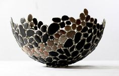 A unique bowl with a contempory feel made from coal found on my local beach. The main part of the bowl is made from coal, a broad sweep of pink beach pebbles creates interest and beauty.  The coal and pebbles are individually copper foiled and soldered together. A simple circle of soldered coal creates a non attached base, giving freedom to place the bowl in a chosen position that appeals to you.  Whitehaven in cumbria has a rich mining past, coal was mined along the coast, many seams mined…