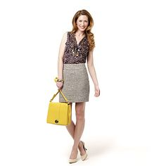 Make sophisticated suits fun for the office and pair them with a print, ruffled, or tie-neck blouse.