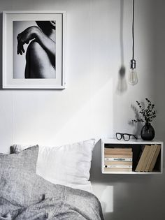 bedroom with floating shelf nightstand and picture                                                                                                                                                                                 More
