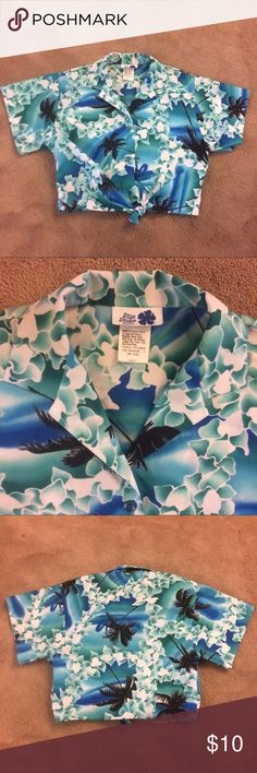 Hillo Hattie Blue & Green Hawaiian Crop Top This Hawaiian T-Shirt is the perfect piece for your summer or vacation wear. It is super cute and stylish. This is a Button Down Crop Top. Theres 2 buttons. The bottom of the shirt is longer than the back to knot.   Measurements  Length 18 1/2 inches Shoulder Width 16 1/2 inches Bust 17 3/4 inches Sleeve length 6 1/2 inches   (The measurements were taken with the shirt knotted at the bottom.)   All measurements are approximations hillo hattie Tops…