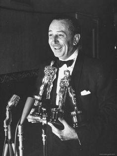 Movie producer Walt Disney holding four Oscar awards he won for best feature-length documentary, short documentary, cartoon & two-reeler at Academy Awards ceremony . Disney Theme, Disney Love, Disney Magic, Disney Art, Walt Disney World, Disney Pixar, Disney Stuff, Disney Humor, Disney Family