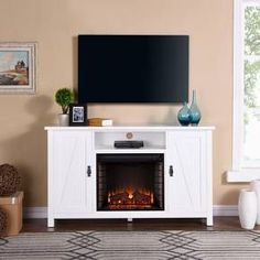 The Aiden Lane Adderline Farmhouse Style Electric Fireplace TV Stand brings the charm of the simple life into your busy routine. Open media shelf holds your accessories, cupboards store games, and fireplace console's broad mantel becomes your flat screen TV stand.