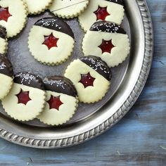 "Chocolate Dipped Linzer Cookies via this blog, ""Haniela's""."