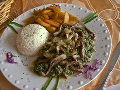 Ndolé is the national dish of Cameroon. It is a stew of walnuts and ndoleh (u .- Il Ndolé è il piatto nazionale del Camerun. E' uno stufato di noci e ndoleh (u… Ndolé is the national dish of Cameroon. Cameroon Food, West African Food, National Dish, Shellfish Recipes, Eating Light, Canadian Food, Caribbean Recipes, Caribbean Food, Food Staples