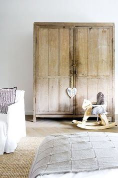 Love this armoire! Thinking the hubby might be able to make something like this.