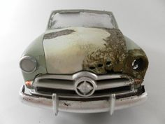 Ultra cool! Car models made to look like salvage yard wrecks. AWESOME!
