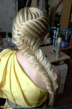 This looks like a fishtail braid I want to do it in my hair sometime:) :)!!