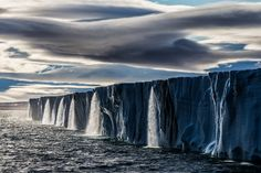 Picture of a string of waterfalls coming from the ice cap in Nord Austlandet.