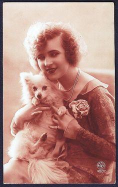 Pretty Deco Lady hugs Spitz Pomeranian DOG, original old RPPC posted 1927