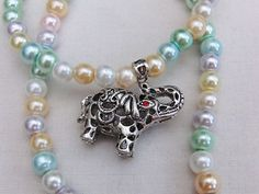 Silver Elephant With a Red Eye Pendant on a Beaded Necklace, Jewellery… Gifts For Pet Lovers, Gifts For Friends, Gifts For Her, Beaded Necklace, Beaded Bracelets, Pendant Necklace, Pretty Necklaces, White Beads, Animal Jewelry