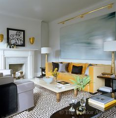 Steven Gambrel ~ A painting by David Smith hangs over the fireplace and a large canvas covers the wall behind the sofa in the sophisticated living room