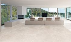 A very chic white porcelain tile which looks superb in this stunning contemporary lounge area. Douglas Jones, White Porcelain Tile, Contemporary Lounge, Flagstone Flooring, Exterior Cladding, Interior Decorating, Interior Design, Wall And Floor Tiles, Lounge Areas