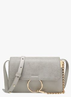 Esbeda Twist Clasp Sling Bag purchase from koovs.com | Bags Online ...
