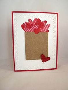 handmade Valentine ... paper bag Valentine ... great idea: brown packing paper bag + bunch of punched hearts overflowing from the top ... like the lone heart placed at the bottom corner ... fun card ... Stampin' Up!