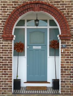 Lovely front door with arched brick entry and front porch. Teal green or blue front door. Front Door Porch, House Front Door, Front Doors, 1930s Porch, Entrance Doors, Garage Doors, Entrance Halls, Doorway, 1930s House Exterior