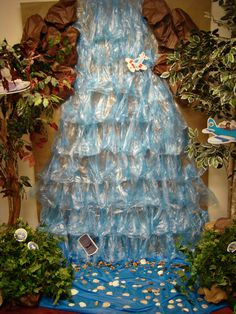 There isn't a description of how to make this, but the water could potentially be blue saran wrap...