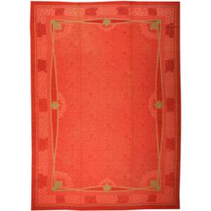 Antique French Art Deco Rug | A small-scale tone-on-tone design of lilies floating on rippling water is barely discernible within the soft red field.