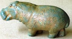 Egyptian faience. 2920B.C. I bought a reproduction of this as a gift for a friend from the Museum Store and someone stole it out of my car...