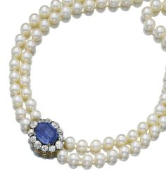 CULTURED PEARL, SAPPHIRE AND DIAMOND NECKLACE The clasp set with a cushion-shaped sapphire weighing 17.27 carats, within a border of circular-cut diamonds, to two rows of cultured pearls,