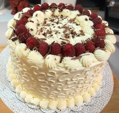 Raspberry and Chocolate Ganache Cake with White Chocolate Buttercream, via Flickr.