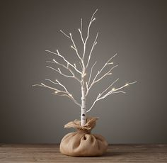 Cultivate a winter forest with trees that lend a magical glow to indoor and outdoor settings. The branches, wrapped in birch or dusted in snow and warm-white lights, look elegant on their own or can be strewn with garlands and ornaments. Each tree features both an on/off switch and built-in 24-hour timer.
