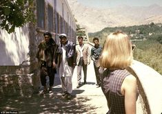 Taking in the view: A blonde Peg Podlich pictured in Kabul, shortly after arriving, as lo...