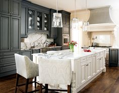 Dark cabinets, white island, LOVE the pendant lighting.   Too bad there's no way the bar stools can actually pull up to the bar...  greige: interior design ideas and inspiration for the transitional home by christina fluegge: Grey in the Kitchen..
