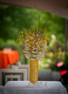 Tall Centerpiece of Oncidium and Dendrobium Orchids in Yellow Urban Chic and Textured Vase - The French Bouquet - James Walton Photo