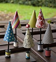 Crafty Trees by Leslie Ashe.  Whilst she created these as Christmas Trees, I can see these cuties as Magic Forest Trees decorating the craft studio. Great way to use scraps.