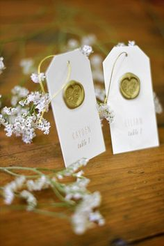 Chic gold seal escort cards.
