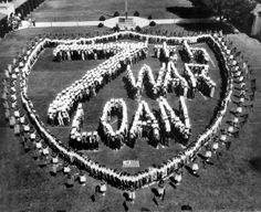 High school students form a US Coast Guard shield, to make a striking appeal for support of the 7th War Loan drive, in Long Beach, CA, 1945. Each purchase of a war bond helps deliver a blow against the Japanese. (Photo by US Coast Guard/Interim Archives/Getty Images)