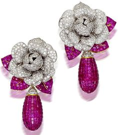 Pair of ruby and diamond day/night earrings.  each designed as a floral surmount of pavé-set round brilliant-cut diamonds, accentuated by calibré-cut ruby leaves and suspending a detachable drop of calibré-cut rubies; estimated total diamond weight: 10.50 carats.