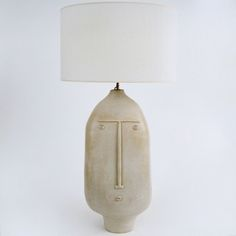Important biomorphic lamp-base, earthenware glazed in pale beige. Could be also displayed as a floor lamp considering the dimensions.
