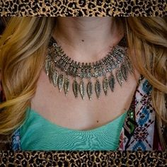Silver feather necklace and earrings set!  (beautifulyoubymegan.com)
