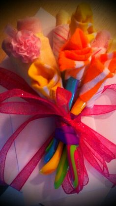 Baby shower bouquet! Socks, washcloths and baby spoons for stems!