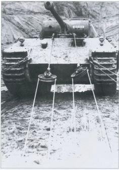 My take on this photo (being tanks came equipped with very heavy tow cables) that this Panther is attempting to pull a lighter vehicle out of a predicament. Very heavy cables would be used to move a heavier disabled tank.