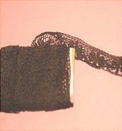Black cotton lace.  Lace on website http://barbspencerdolls.com is sold by piece, by yard, lots....  Look in LACE 1 and LACE 2.  New, Vintage and Antique!