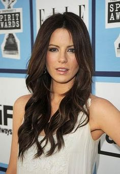Long wavy hair and a beautiful dark brown color laurieburns