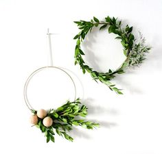 Scandinavian Modern Wire and Boxwood Wreath with Natural Wood Balls. Christmas Decorating that looks good all year.
