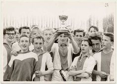 Ajax youth team, the winners of the youth tournament, with their cup, 1962 15-year-old JohanCruyff is second from right in the bottom row.