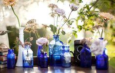 floral, centerpieces, flowers, gerber daisies, queen anne's lace, rose, real, lace, vintage , blue, blues, cobalt, decor, decoration, decorations, flower, hues, navy, reception, table, tables, theme, deep, vibrant, vase, wedding
