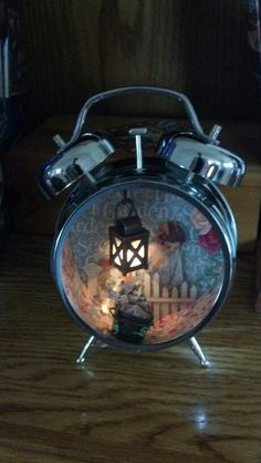Tim Holtz assemblage clock and mini lantern, with Graphic 45 Secret Garden paper