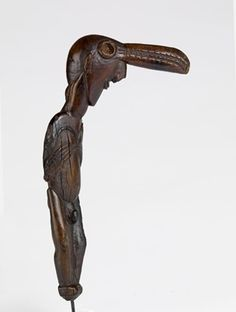 Fish-headed man figure carved from wood. British Museum