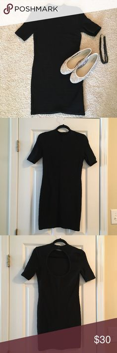 """{Top Shop} Little Black Dress Super cute little black dress!  Size 8 but it fits more like a 6.  Approximately 33"""" from shoulder to base.  Has an open back with two small buttons to connect near the base of the neck.  Great textured stretchy material! Top Shop Dresses Midi"""