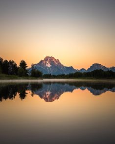 Photo by @michaelclarkphoto // Sunrise on Mt. Moran reflected in Oxbow Bend in Grand Teton National Park Wyoming. #grandteton #tetons #grandtetonnationalpark #wyoming #mtmoran by natgeotravel